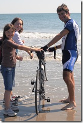 The family dips wheel in ocean